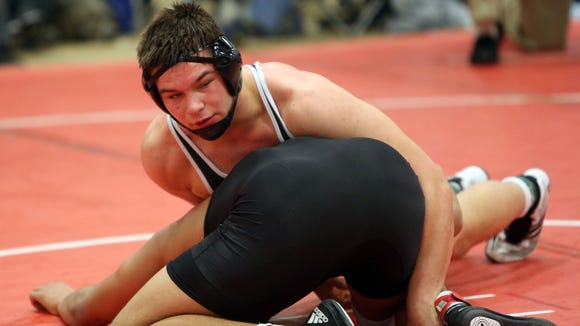 John Jay's Hali Gecaj and John Glenn's Damien Caffrey wrestle in the semifinals of the 220-pound weight class during the Eastern States Classic Wrestling Tournament at Sullivan Community College in Loch Sheldrake, N.Y. Jan. 14, 2017.  Caffrey won the match.