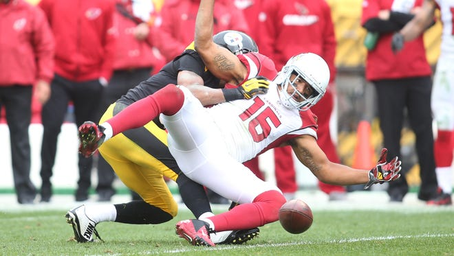 Oct. 18, 2015; Pittsburgh; Pittsburgh Steelers defensive back Ross Cockrell (rear) commits pass interference against Arizona Cardinals receiver Michael Floyd (15) during the fourth quarter at Heinz Field.
