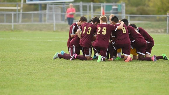 Arlington's team goes into a huddle before Monday's game against John Jay.