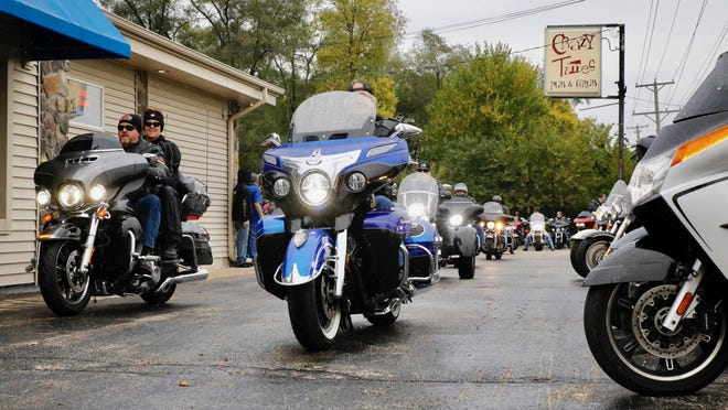 Approximately 250 law enforcement supporters line up on motorcycles in the parking lot of Crazy Times Pub and Grub in Machesney Park on Saturday to take off for a 100-mile ride through Winnebago and Ogle counties for a Back the Blue Rally.
