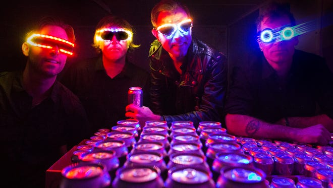 """Boston band The Lights Out, including bass player and Vermont native Matt King, has released its new album, """"T.R.I.P.,"""" via beer cans."""