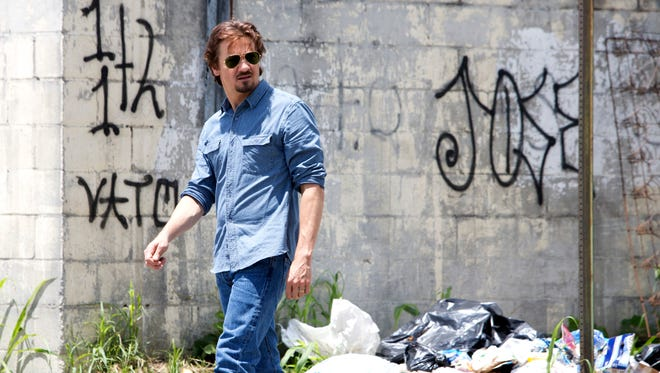 """Jeremy Renner as dedicated reporter Gary Webb in a scene from the motion picture """"Kill the Messenger."""""""