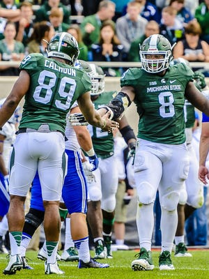 Shilique Calhoun ,89, and Lawrence Thomas ,8, of MSU celebrate after a defensive stop against Air Force forcing a 4th and 3 early in the 4th quarter of their game Saturday September 19, 2015 in East Lansing. KEVIN W. FOWLER PHOTO