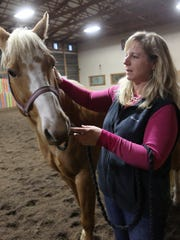 Martha Becker, who is certified in the Masterson Method, works with Chevy at the Ridgetop Horse Ranch near Milo on Nov. 4.