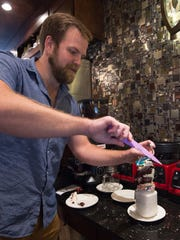 Kyle Ten Eyck, co-owner of Mug & Spoon in Rehoboth Beach, puts together their Cake by the Ocean milkshake.