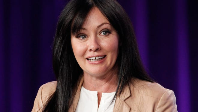 """In this Jan. 14, 2012, file photo, Shannen Doherty participates in a panel for the television show """"Shannen Says"""" on WE tv in Pasadena, Calif."""