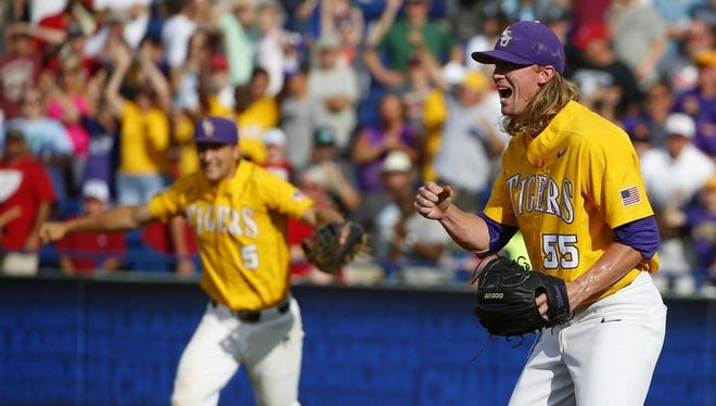 LSU pitcher Hunter Newman (55) reacts after the last out to beat Arkansas 4-2 during the ninth inning of the SEC championship game.
