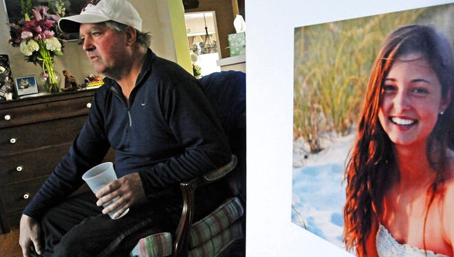 In this Jan. 23, 2014 file photo, James Holleran, father of Madison Holleran, a University of Pennsylvania freshman who took her own life, talks about his daughter while sitting next to a favorite photo of her at his home in Allendale, N.J.