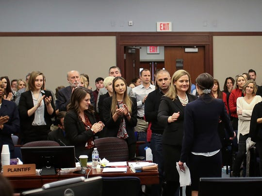 Assistant Attorney General Angela Povilaitis, center, reaches out to hug Rachael Denhollander on Wednesday, Jan. 24, 2018, after Denhollander gave her victim-impact statement in Ingham County Circuit Court. Denhollander was the first to go public in the Nassar scandal.