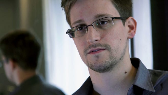 Snowden Edward Snowden leaked top-secret documents. FILE - This Sunday, June 9, 2013 photo provided by The Guardian newspaper in London shows Edward Snowden, who worked as a contract employee at the U.S. National Security Agency, in Hong Kong. Posts to online blogs and forums, public records and interviews with Snowden'€™s neighbors, teachers and acquaintances reveal someone who prized the American ideal of personal freedom but became disenchanted with the way government secretly operates in the name of national security. (AP Photo/The Guardian)