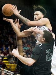 New Mexico State's Jermaine Haley drives the lane and is fouled by Chicago State's Patrick Szpir and Delundre Dixon Saturday night at the Pan American Center.