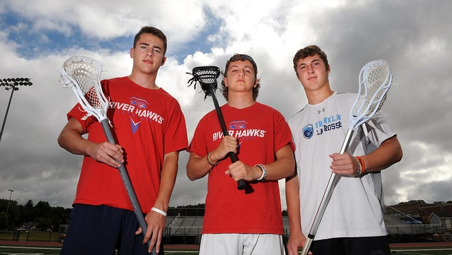 The line of Franklin High School lacrosse co-captains Matt Lazzaro, Ben Greco, and Jake Davis pose at Franklin High on Wednesday.