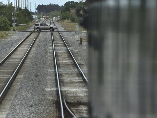 Traffic crosses the 49th Street railroad tracks in Gifford, as seen looking south from the driver's seat of a Florida East Coast Railway locomotive, on April 20, 2016. (ERIC HASERT/TREASURE COAST NEWSPAPERS)