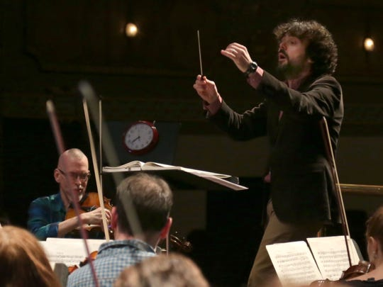 Octavio Mas-Arocas conducts the Mansfield Symphony Orchestra during a rehearsal at the Renaissance Theatre on Thursday evening. Mas-Arocas is one of the finalist for the music director position for the orchestra.