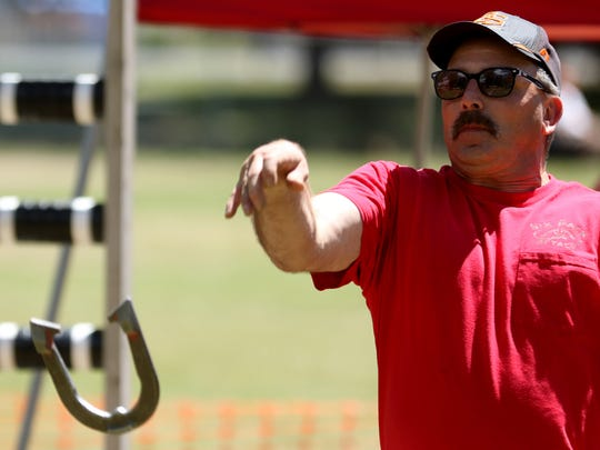 Rod Beaumont, 51, of Mill City, competes in a horseshoe
