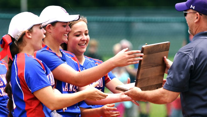 Lakewood players accept the Division II regional championship trophy following a 15-1 win against Maysville on Saturday at Pickerington Central.