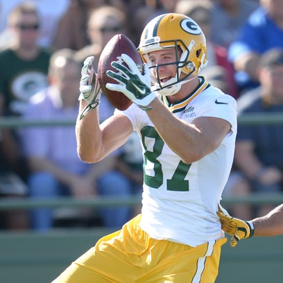 Receiver Jordy Nelson (87) chuckles as he makes a catch