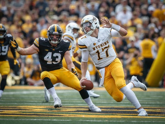 Iowa senior linebacker Josey Jewell, left, chases Wyoming quarterback Josh Allen late in the second quarter at Kinnick Stadium in Iowa City on Saturday, Sept. 2, 2017.