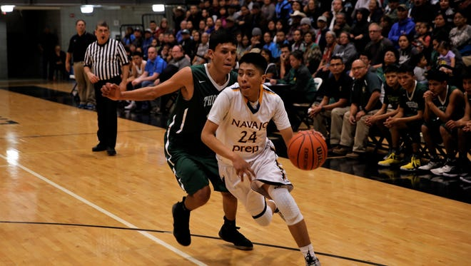 Navajo Prep's Treston Yazzie drives past Thoreau defender Donovan Saunders during Thursday's District 1-4A tournament semifinals at Navajo Prep. Visit daily-times.com for the latest basketball scores, photo galleries and sports video highlights.