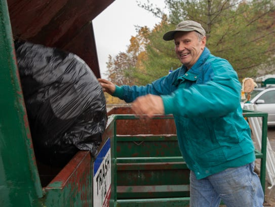 Dick Francis drops trash off at the Chittenden County