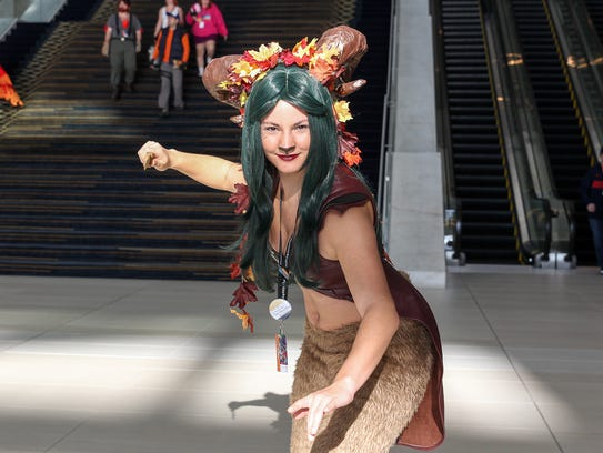 Nicole Trudeau, of Howell poses in her Forest God costume