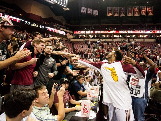 Students celebrate with the Florida State basketball