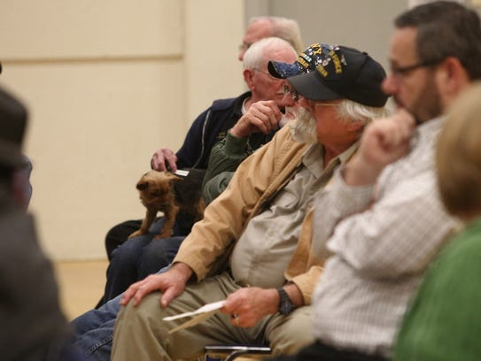 U.S. Air Force veteran Steve Williams listens at a