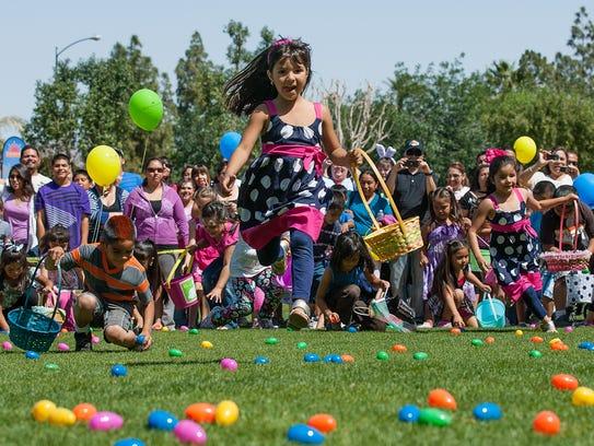 Nicole Zavala (middle), 5, of Indio leaps over Easter