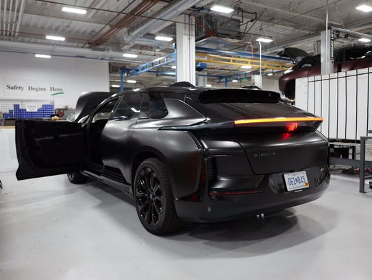 A Faraday Future FF 91 sits waiting for some adjustments.