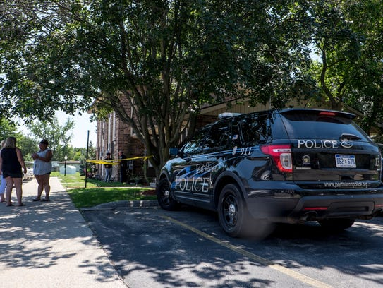 Police are investigating a body found inside an apartment