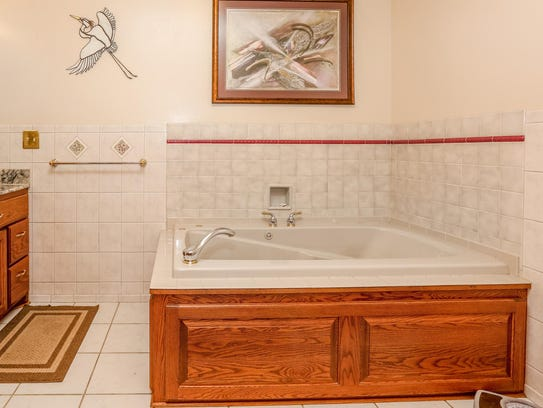 Relax in the bath at 7095 Island View Road NW, Sauk