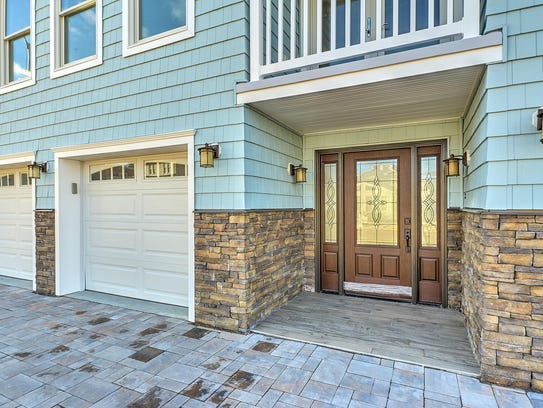 This home offers maintenance free stone pavement.