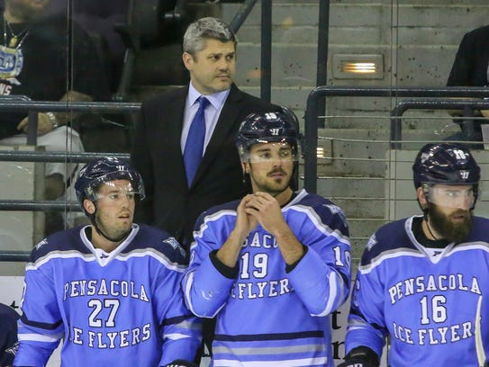 Ice Flyers head coach Jeff Bes looks on during the