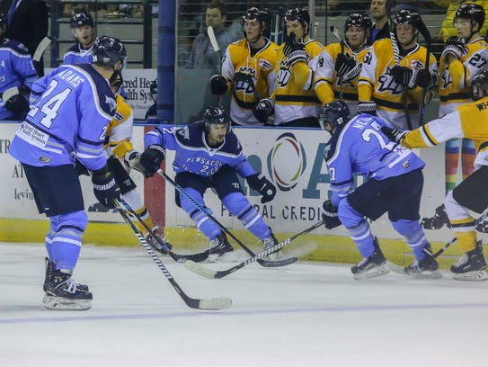 The Ice Flyers try to get control of the puck against