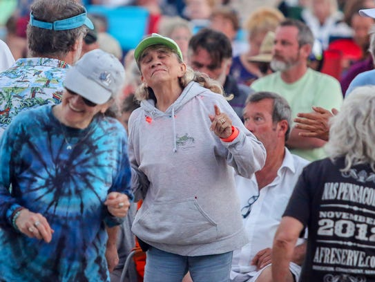 Hundreds of people enjoy the first night of Bands on the Beach, featuring Gretsch Lyles and the Modern Eldorados, at the Pensacola Beach Gulfside Pavilion on April 3. This Tuesday's entertainment features Not Quite Fab.
