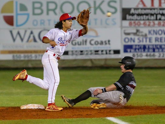 Tate's Reid Halfacre (1) steals second base before