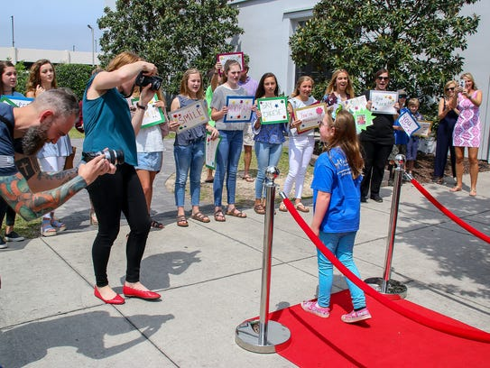 Bella Salada, 8, makes her way down the red carpet