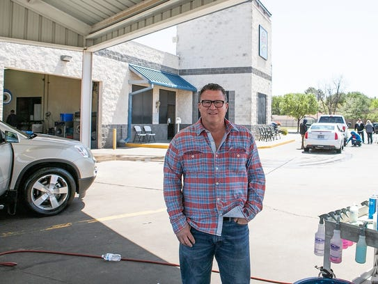 Larry Ayers at one of the car washes he owns in Wichita