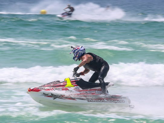 Jet skiers compete in the Pro Watercross Tour, presented
