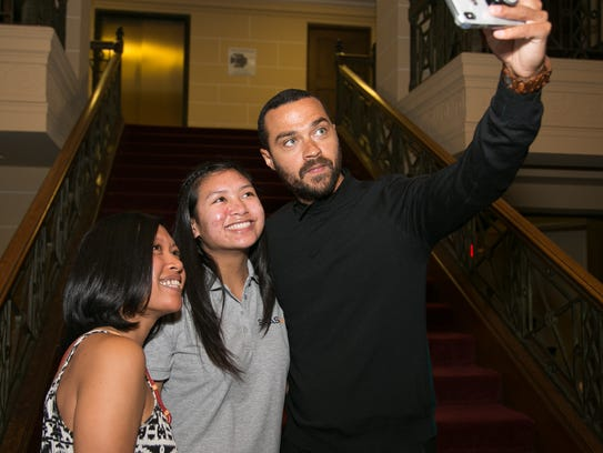 Jesse Williams takes a selfie with fans (Photo: Ashleigh Reddy for Stayreddy Photography)