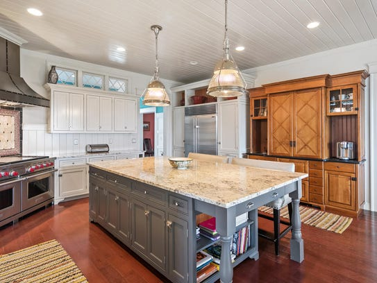 The gourmet kitchen offers grade-A appliances, butler's pantry, and recessed lighting.