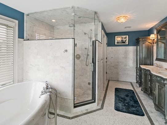 The Master bathroom features a soaker tub, with his and hers customized sinks.