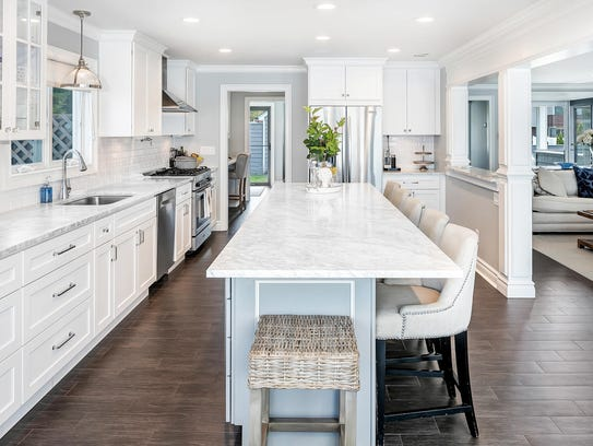The kitchen offers an expansive granite center stone island and counter-tops with stainless steel appliances.