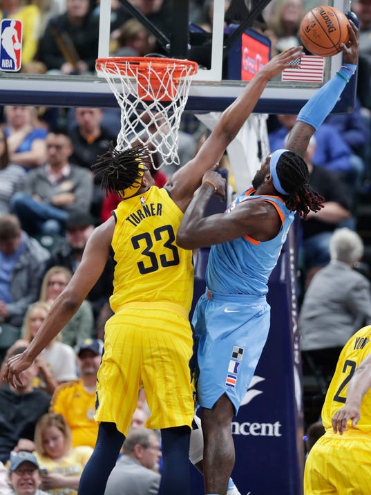 Los AngelesClippers center DeAndre Jordan (6) is fouled by Indiana Pacers center Myles Turner (33) on a dunk during the second half of an NBA basketball game in Indianapolis, Friday, March 23, 2018. The Pacers defeated the Clippers 109-104. (AP Photo/Michael Conroy)