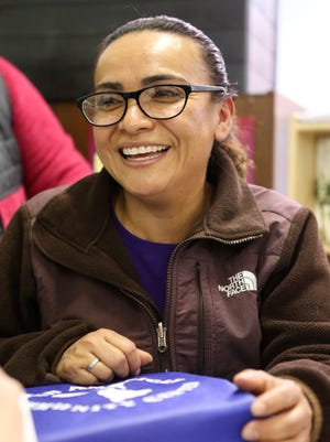 Angelica Morales, who owns a cleaning service, is learning how to take her business further in the Launcher entrepreneurship training program at West End Neighborhood House in Wilmington.