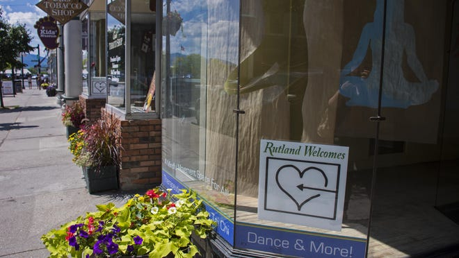 """A """"Rutland Welcomes"""" sign and logo appear on Center Street on July 27, 2016."""