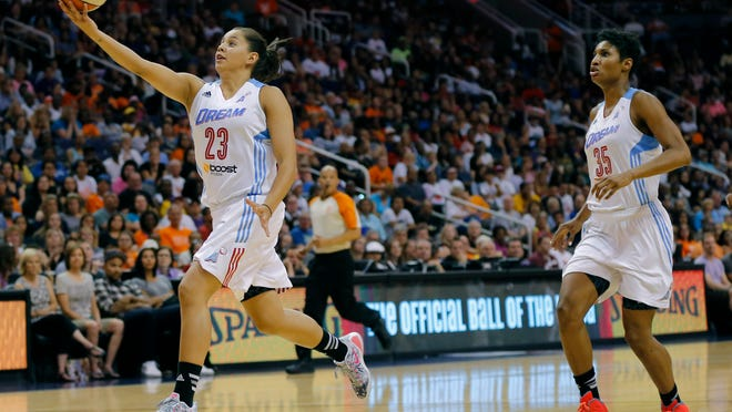 Shoni Schimmel passes off the backboard to Atlanta Dream teammate Angel McCoughtry during the second half of last year's WNBA All-Star game.