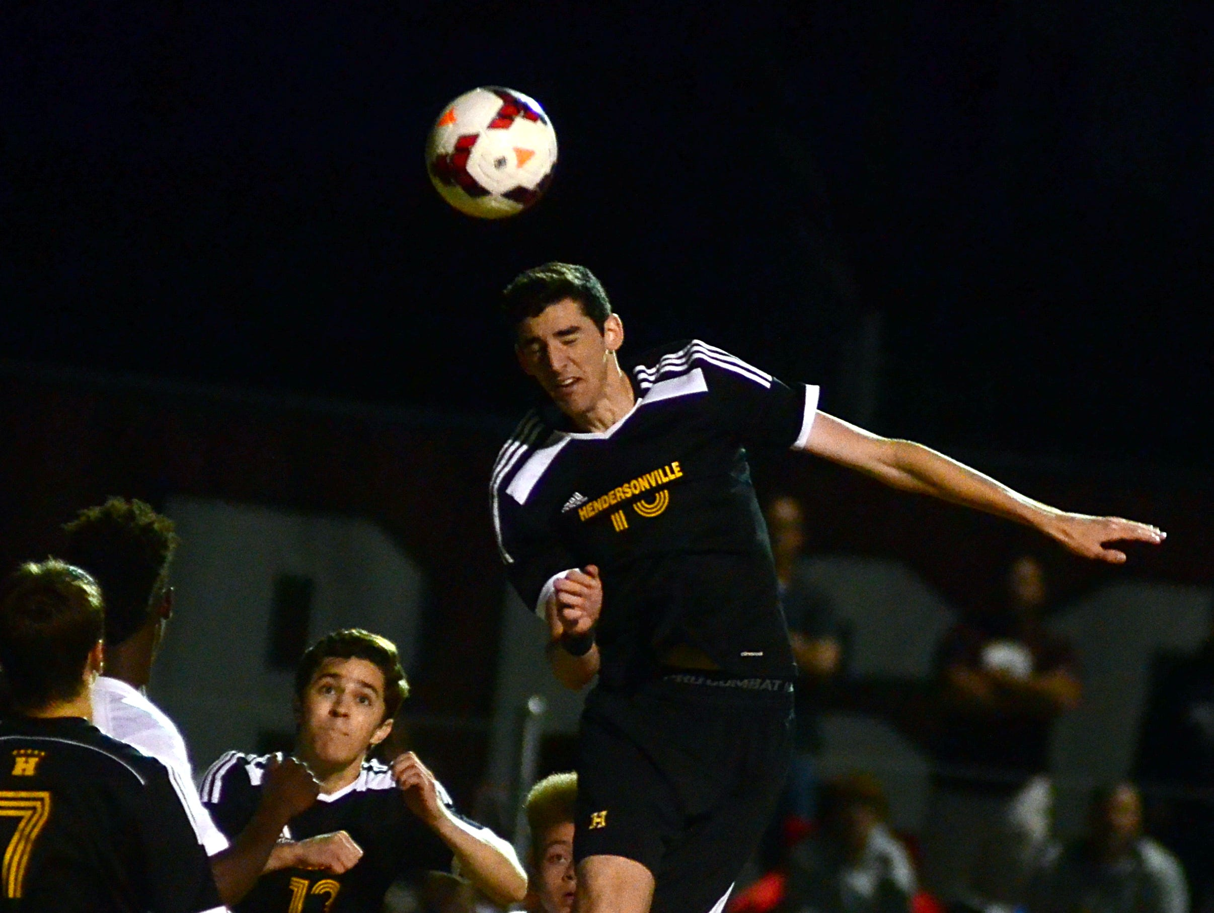 Hendersonville High senior Reed Coffman heads a ball in the box during second-half action. Coffman scored Hendersonville's lone goal in Thursday evening's 2-1 loss at Station Camp in the Region 5-AAA Tournament championship matchl.