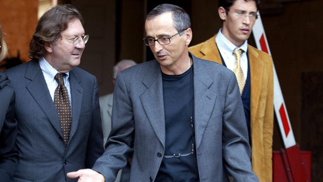 This file picture taken on Oct. 1, 2004 in Bologna shows Italian sports doctor Michele Ferrari (R) gesturing as he talks with his lawyer Dario Bolognesi as they leave the Bologna's tribunal.
