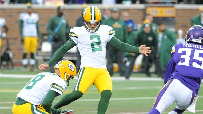 Green Bay Packers kicker Mason Crosby (2) kicks one of his five field goals against the Minnesota Vikings at TCF Bank Stadium in Minneapolis November 22, 2015.